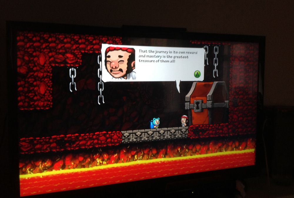 """Photo of a TV screen showing the secret Hell ending of the videogame Spelunky. The screen has the character Yang giving a quote: """"That the journey is its own reward and mastery is the greatest treasure of them all!"""""""