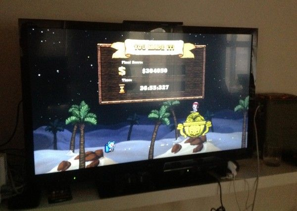 """Photo of a TV screen showing a successful """"Hell"""" run of the videogame Spelunky. A user interface menu reads """"YOU MADE IT!"""" and shows a (difficult-to-read) final score above $30,000, and a time above 36 minutes."""
